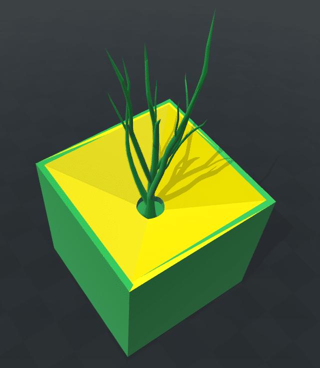 Die Pflanzbox mit einem Baumsetzling bepflanzt.